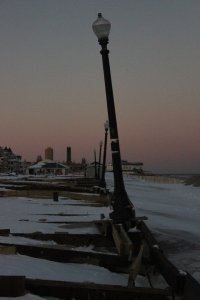 Lamp posts still standing on the destroyed boardwalk of Ocean Grove, NJ ... at sunset
