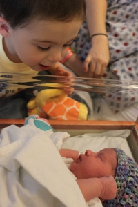 Big brother Cole and his brand new sister