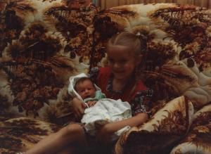 7 year old Aunt Becca holding 3 day old Kimberly Kay